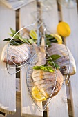 Fresh sea bream with bay leaves & lemons ready for grilling