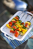 Raw vegetable kebabs ready for grilling