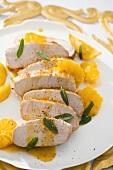 Pork fillet with orange and lemon sauce and sage