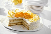 Orange and lemon cake with grated coconut, a piece taken