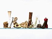 Still life: spices, avocado, almonds & glass of sparkling wine