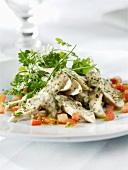 Poultry salad with mustard dressing and coriander leaves