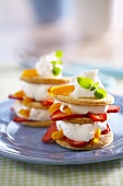 Towers of biscuits, cream, strawberries and peaches