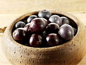 Acai berries in wooden bowl