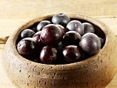 Acai berries in wooden bowl