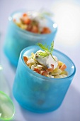 Vegetable salad with dill and yoghurt in blue glasses