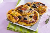 Two vegetable pizzas with sweetcorn and cheese