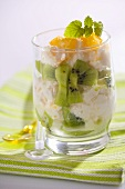 Kiwi fruit, mandarin oranges and cream in glass