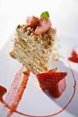 Piece of peanut cake with strawberries