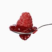 Raspberry jam and raspberry on spoon