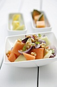 Melon salad with pine nuts and onions
