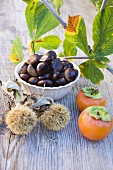 Sweet chestnuts, persimmons and chestnut leaves