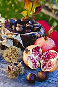 Pomegranates, sweet chestnuts and autumn leaves