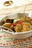 Pork curry with raisins (India)