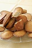 Buckwheat madeleines on cake rack