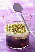 Pears in red wine with cream and chopped pistachios