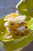 Tower of Parmesan crisps, soft cheese and pear slices
