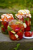 Pickled tomatoes in jars out of doors