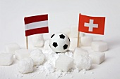 Sugar, football and flags of Austria and Switzerland