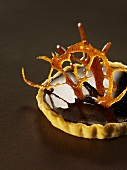 Chocolate tartlet with caramel decoration