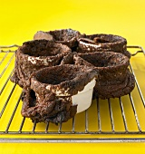 Burst chocolate soufflés on cake rack