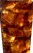 Cola with ice cubes in a glass (detail)