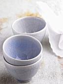 Three pale blue bowls