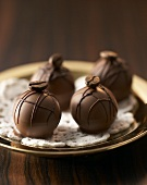 Coffee truffles with mocha beans on plate