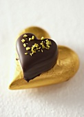Heart-shaped chocolate with chopped pistachios