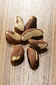 Several Brazil nuts on wooden background