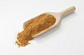 Tandoori masala spice mixture in wooden scoop