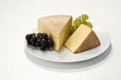 Tilsit cheese and grapes on plate