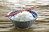 Rice in Asian bowl with chopsticks
