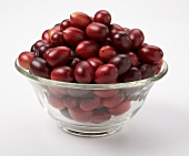 Artificial cranberries in a glass dish