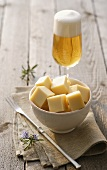 Diced cheese and a glass of beer