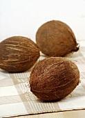 Three coconuts on tea towel