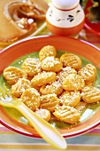 Pumpkin gnocchi, sprinkled with cheese, for children