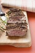 Peppered steak, sliced