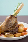 Roast leg of lamb with rosemary, potatoes and carrots