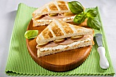 Toasted turkey ham and pear sandwiches