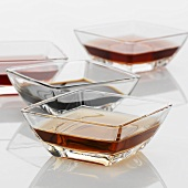 Various types of vinegar in glass dishes