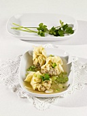 Filled pasta purses with spring onions & coriander leaves