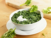Creamed spinach with a spoonful of sour cream
