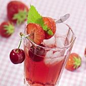 Cold fruit tea with fruit skewer