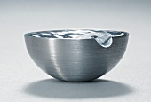 Water wave in metal bowl