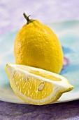Whole lemon and lemon wedge
