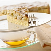 Piece of grape cake on cup of tea