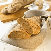 Onion baguettes in bread basket and on chopping board