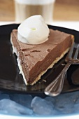 Piece of frozen chocolate pie with cream