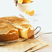 Mandarin orange cake with cinnamon, a piece partly removed